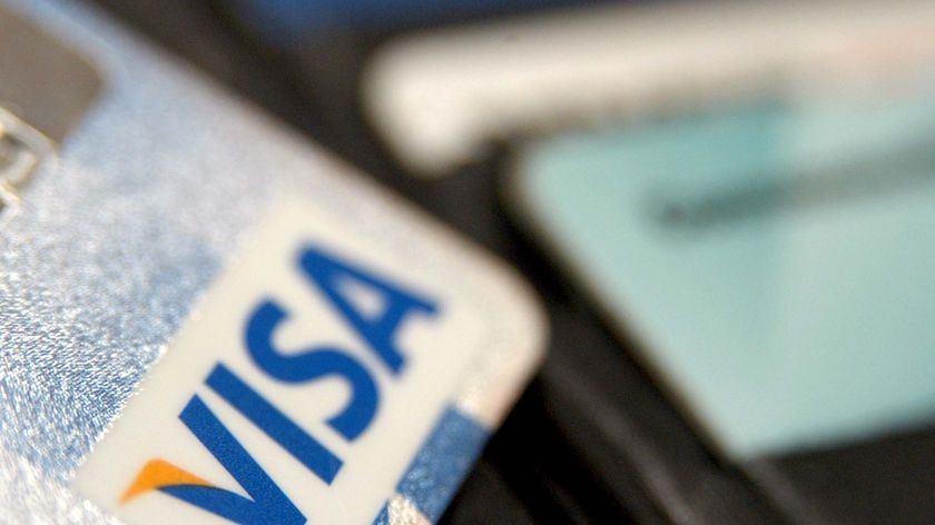 A VISA card sits in a wallet