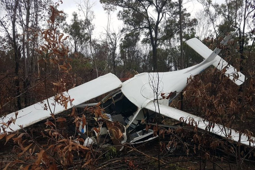 Wreckage of a crashed aircraft lies in bushland near Bundaberg in Queensland.