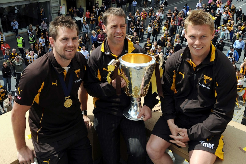Hawthorn's Luke Hodge, Alastair Clarkson and Sam Mitchell with the AFL premiership cup
