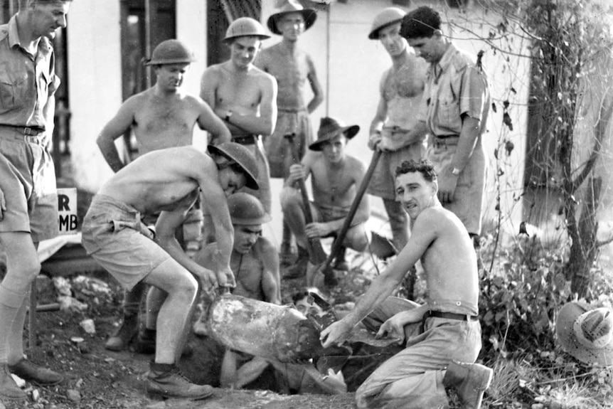 Bomb disposal experts recovering an unexploded Japanese aerial bomb in Darwin