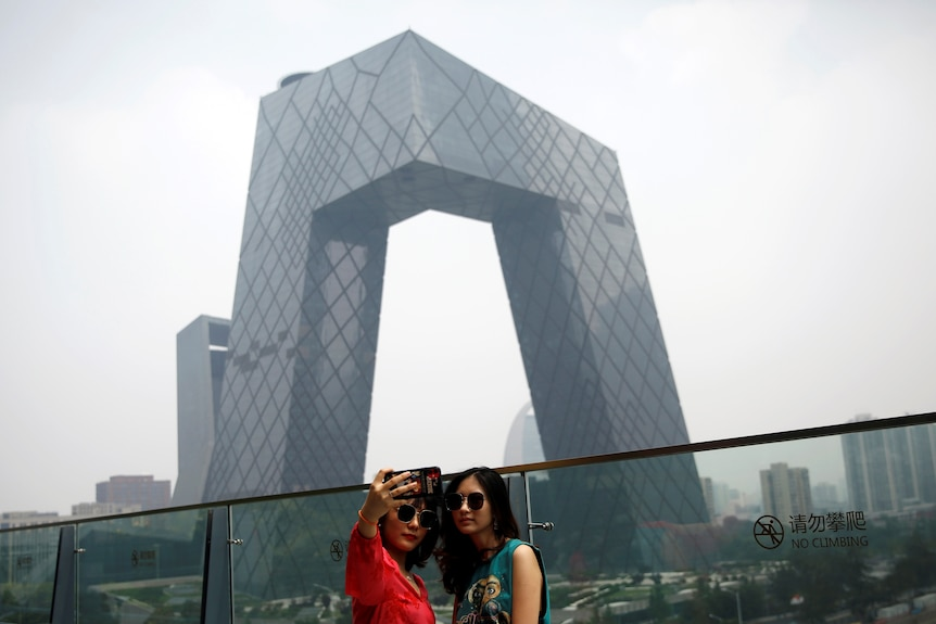 Young people pose for a selfie in Beijing.