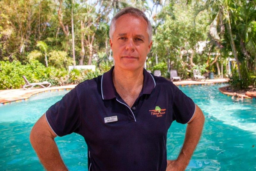 Michael Leake standing in front of swimming pool