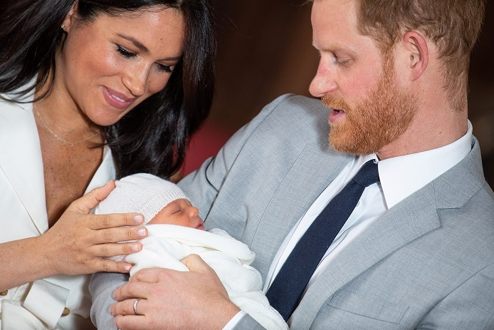 Prince Harry and Meghan, Duchess of Sussex hold their baby son.