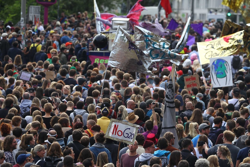 """Crowd of people, some with signs saying """"No G20"""""""
