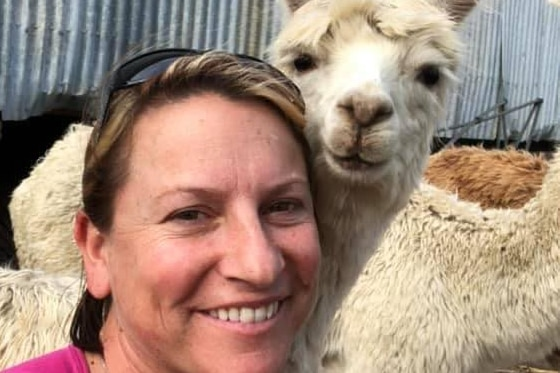 Lady smiling with Alpaca