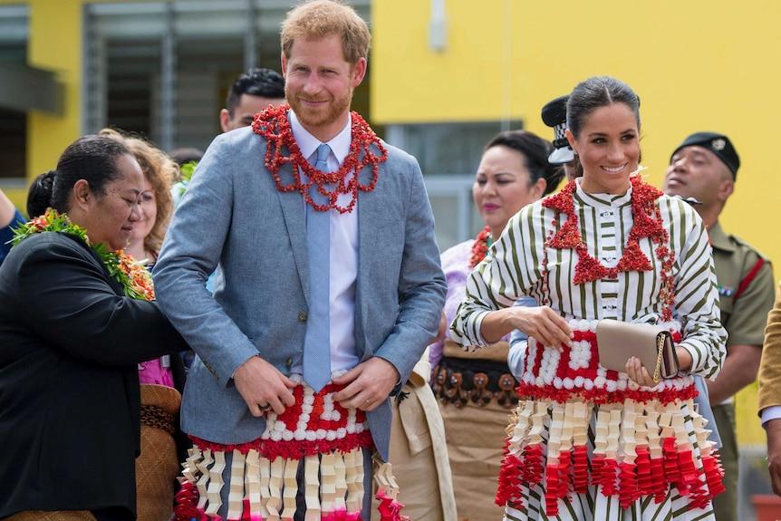 Harry and Meghan wear a ta'ovala, a traditional Tongan dress wrapped around the waist.