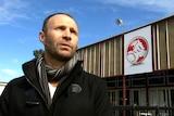 Justin stands outside the Holden factory at Elizabeth.