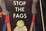 "A poster with the words ""stop the fags"" and two hands holding rainbow coloured belts over a cowering child."