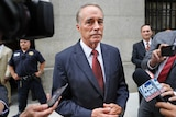 US congressman Chris Collins stands in front of reporters.