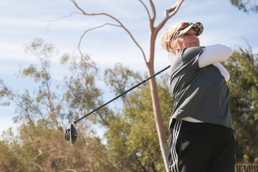 Alice Springs golfer Michelle Sawyer hits off on the first tee.