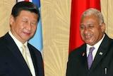 China's president Xi Jinping meets Fiji's prime minister Frank Bainimarama in Fiji