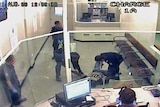TV still of man being tasered at the East Perth lockup in 2008