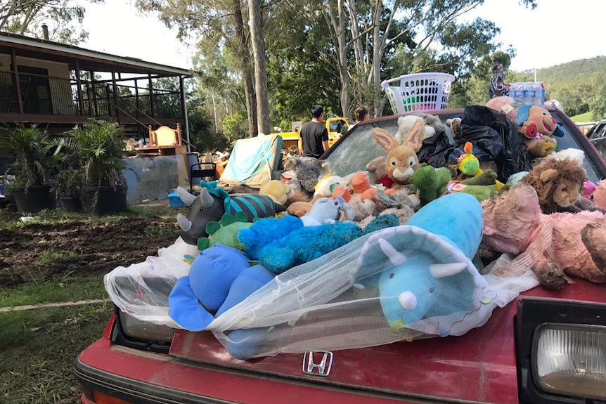 Belongings outside a flooded Luscombe home