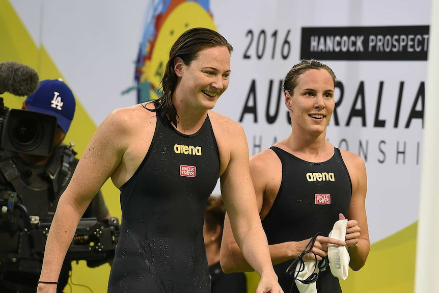 Cate Campbell smiles with sister Bronte Campbell at Australian Swimming Championships in Adelaide.