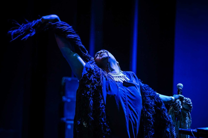 Colour photo of Zaachariaha Fielding performing on stage at Sydney Opera House.