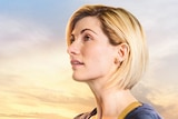 Jodie Whittaker as the Doctor looks off to the left of the screen.