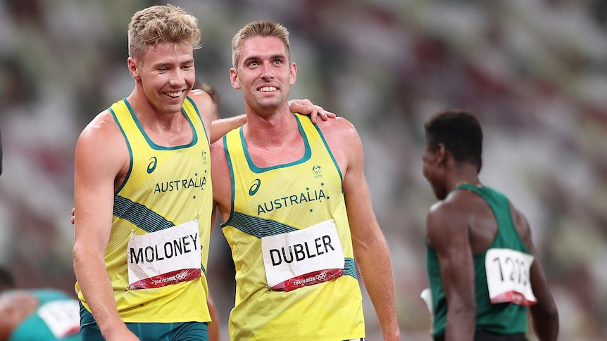 Two Australian decathletes with their arms over each other's shoulders as they celebrate following their event.