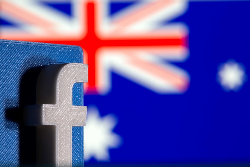 A 3D printed Facebook logo is seen in front of displayed Australia's flag in this illustration.