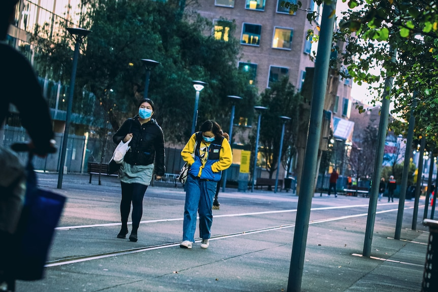 Two young women walking in Ultimo