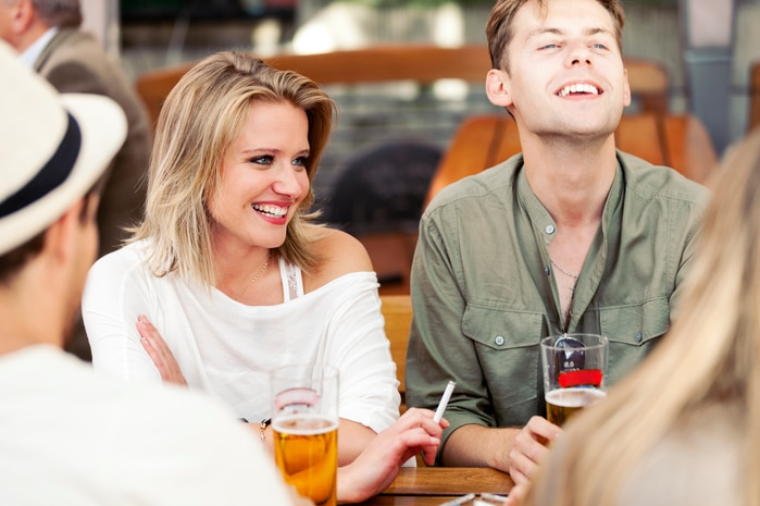 Young people in bar smoking and drinking