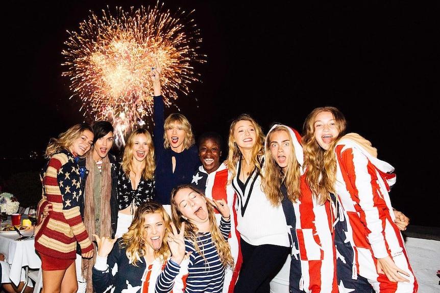 Taylor Swift, Cara Delevingne, Gigi Hadid, Blake Lively and Ruby Rose embrace in front of a bursting firework