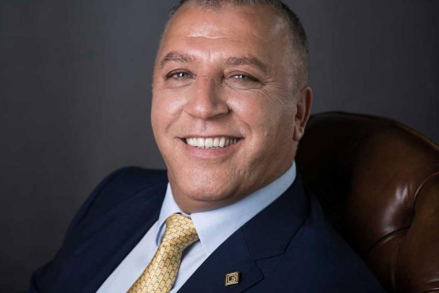 Smiling headshot of Syrian billionaire Ghassan Aboud.