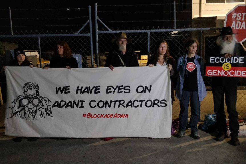 Climate change protesters block the front gates of premises of an Adani contractor.