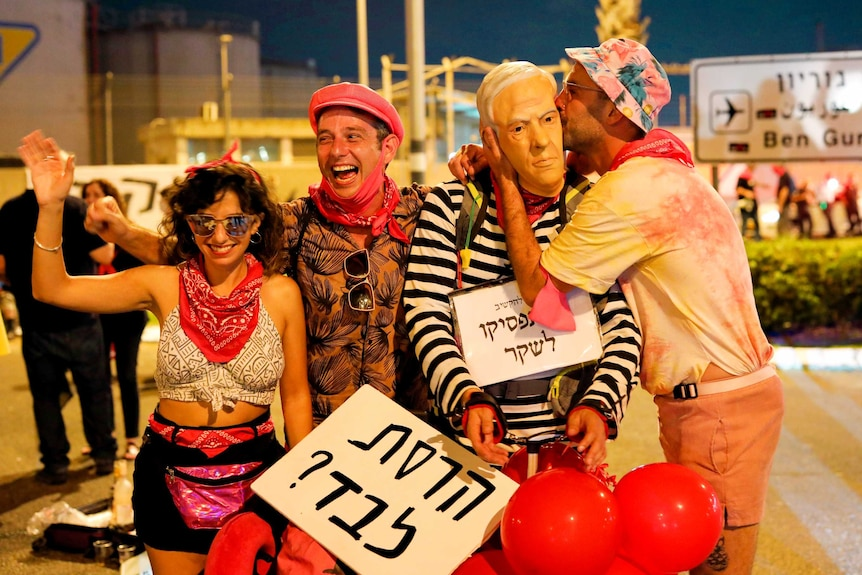 Protesters at an airport in Israel laughing together