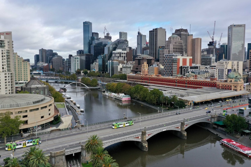 Princes Bridge near Flinders St Station in Melbourne's CBD with hardly any traffic on it.