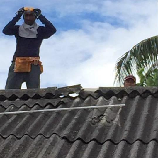 Removing chipped and broken asbestos roofing in Nauru