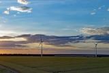 windmills on a green paddock