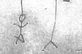 A redacted, scanned photo of a hangman drawing.