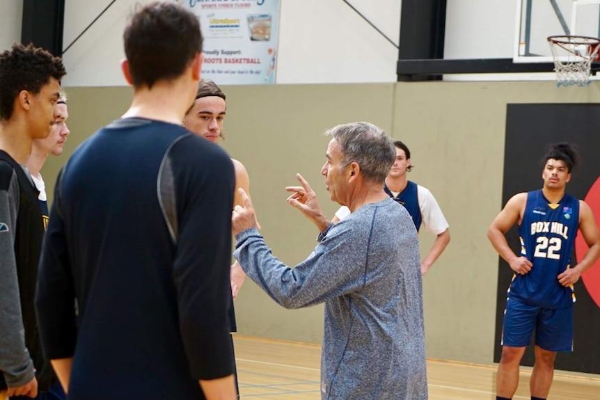 Box Hill Senior College basketball coach Kevin Goorjian talks to his players.