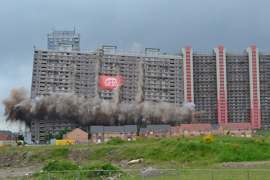 Colour photograph of mid-20th century Red Road Flats in Glasgow being demolished.