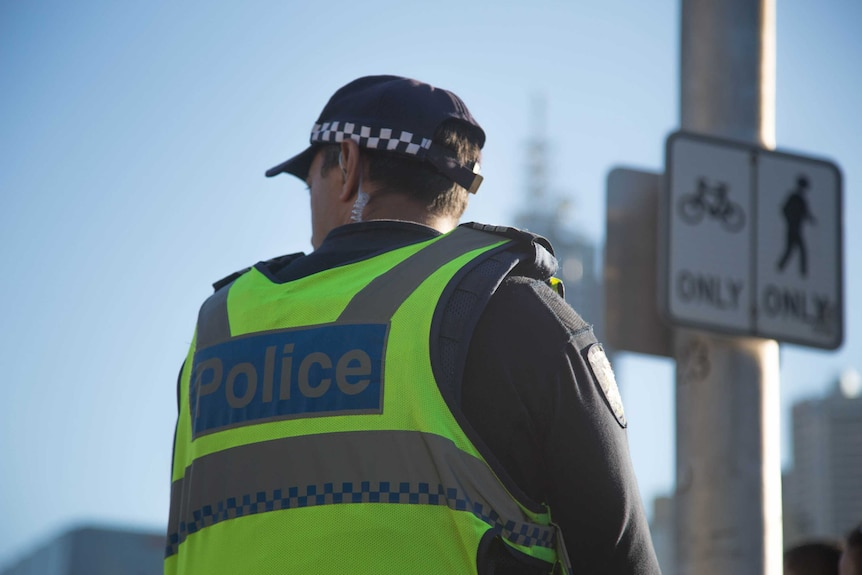 A Victoria Police officer wearing a fluro vest.