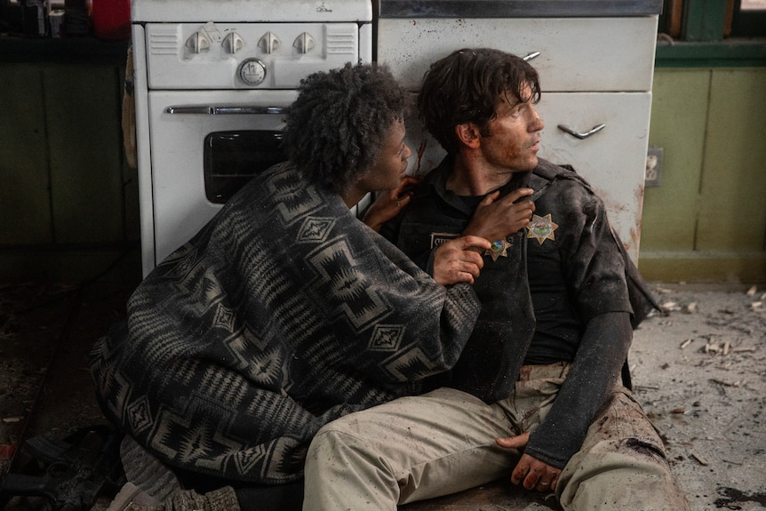 Film still of Medina Senghore as Allison and Jon Bernthal as Ethan sitting on the kitchen floor in Those Who Wish Me Dead