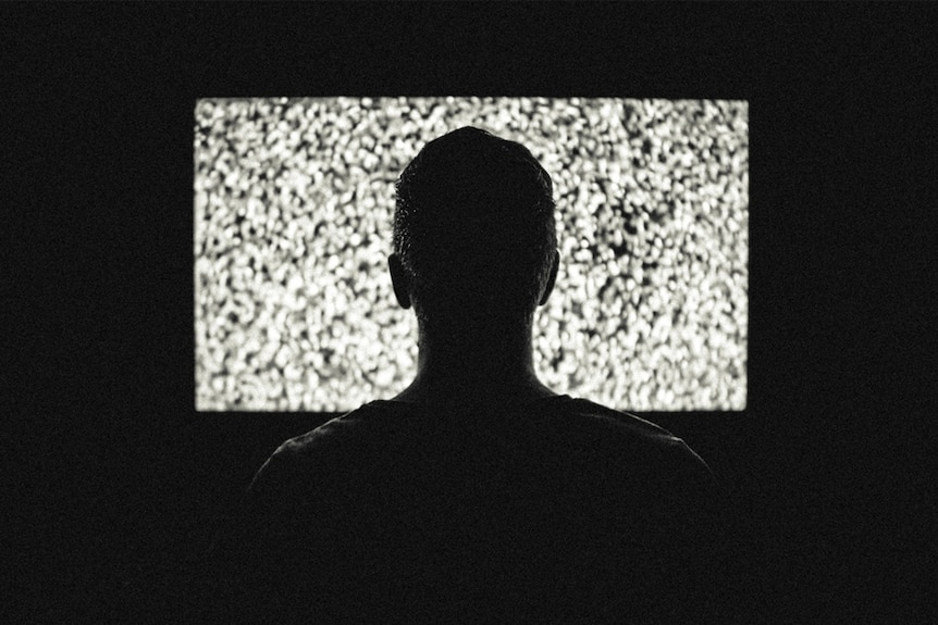 A man watches television.