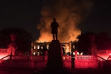 Flames are seen engulfing the museum at night.
