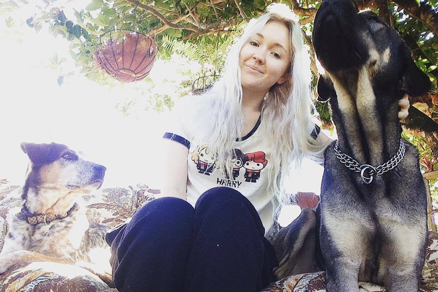 Toyah Cordingley sits with her dogs.