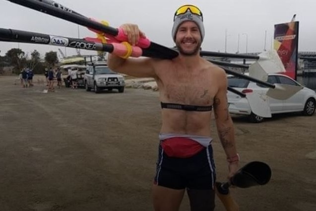 Adelaide para-athlete Jed Altschwager holding his prosthetic leg.