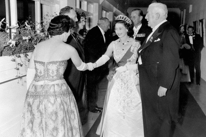 A guest is presented to Queen Elizabeth II at a state reception at Parliament House.