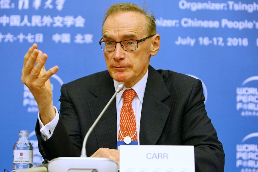 Bob Carr gestures as he speaks during a press conference in China.