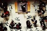 Overhead view of an orchestra conductor