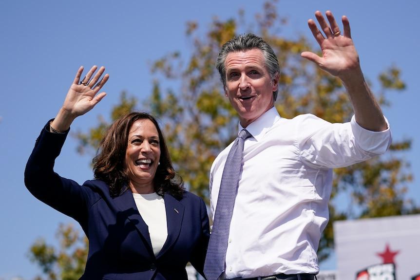 Vice President Kamala Harris waves with California Gov. Gavin Newsom