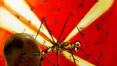 Pro Hart in front of one of his dragonfly paintings in 2002