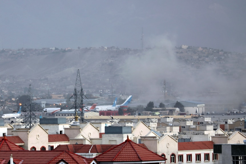 Smoke rises from a deadly explosion outside the airport in Kabul
