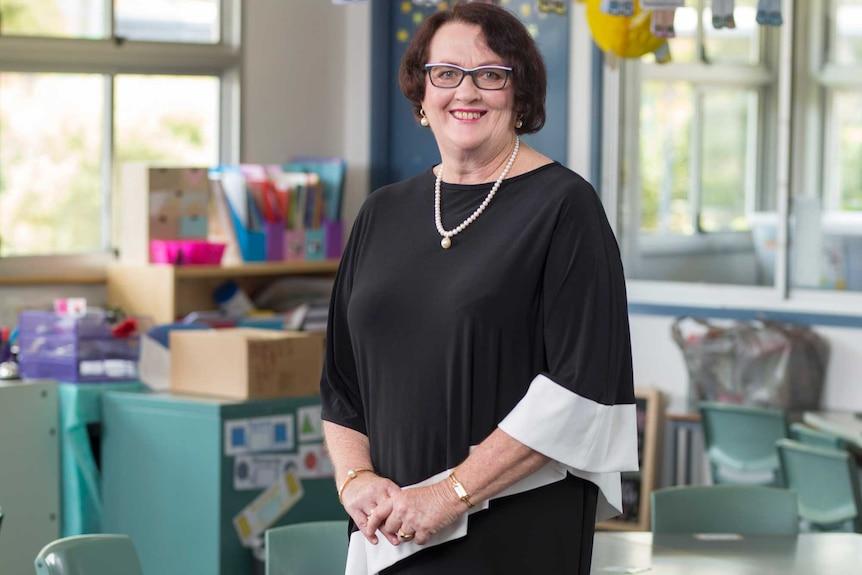 Full-length portrait of Queensland Association of State School Principals president Leslie Single