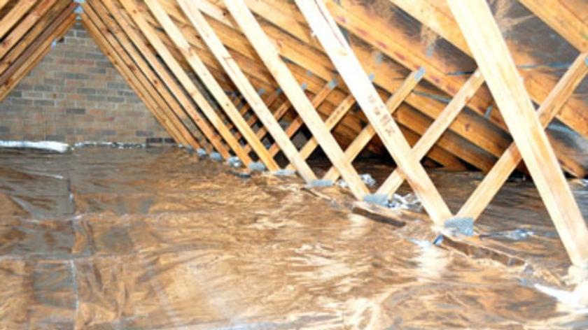 Foil insulation fills a roof cavity.