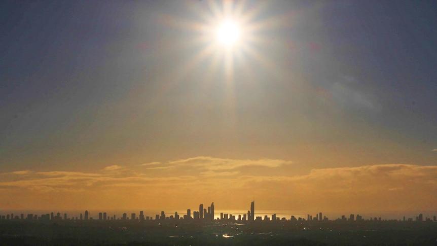 The sun rises high over the Gold Coast skyline