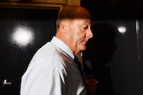 Shadowy image of Daryl Maguire, bald and on a profile